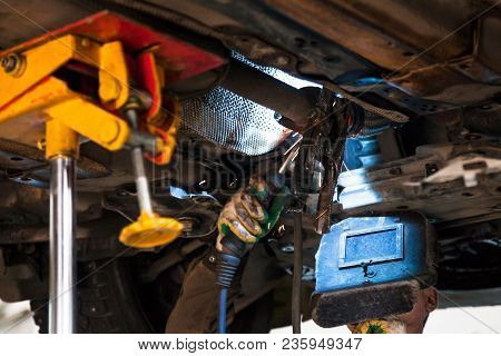 Repairing Of Corrugation Muffler Of Exhaust System In Car Workshop - Welder Repairs The Silencer On