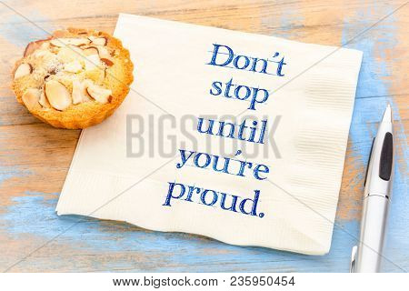 Do not stop until you are proud - inspirational handwriting on a napkin