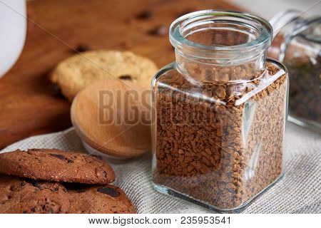 Open Jar Of Instant Coffee Arranged On Woden Table, Top View, Close-up, Selective Focus, Shallow Dep