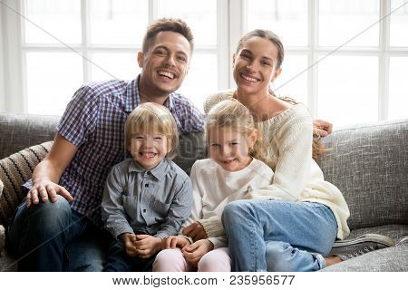 Portrait Of Happy Multinational Family With Adopted Kids Laughing Bonding Together, Smiling Young Co