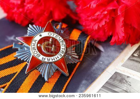 Soviet Order Of Patriotic War (inscription Patriotic War) With St. George's Ribbon And Red Carnation