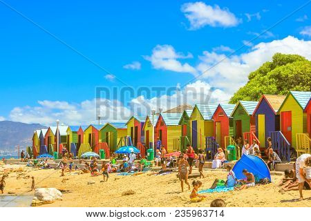 Cape Town, South Africa - January 10, 2014: Many People On Famous Colorful Beach Cabins Of White Bea
