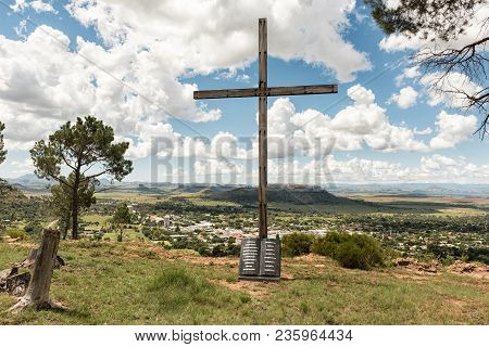 Ficksburg, South Africa - March 12, 2018: A Wooden Cross With The Ten Commandments Engraved On A Gra
