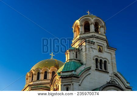 Front View And Sunlit Domes Of Alexander Nevsky Cathedral (completed 1912) Against Clear Blue Sky, S