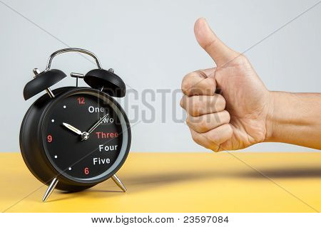 alarm clock with success sign
