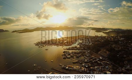 Aerial View Coron City With Slums And Poor District. Palawan. Busuanga Island. Evening Time And Suns