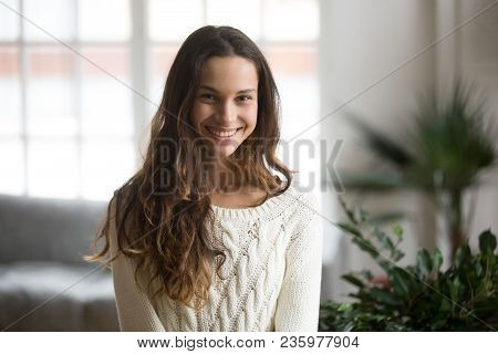 Happy Friendly Mestizo Woman Posing Indoor At Home In Casual Clothes, Teenage Student Or Young Girl