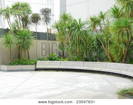 wooden bench in the garden outside office building