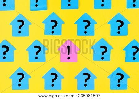 Stickers In The Form Of Houses On A Bright Yellow Background. On Blue Sticky Notes A Question Mark W