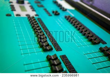Sound Technician Green Audio Mixer Equalizer Control For Background. Close Up Of Music Mixer Equaliz