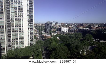 Aerial Elevated View Up Above A Chicago Neighborhood In Summer Under A Blue Sky