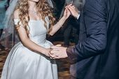 happy stylish bride and groom dancing and having fun at wedding reception in restaurant. guests dancing in light, people in motion at party in club. fun moments. poster