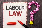 Writing note showing  Labour Law. Business photo showcasing Employment Rules Worker Rights Obligations Legislation Union written Cardboard Piece With Marker wooden background Question Mark. poster