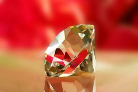 Image Of Crystal On Red Background Closeup