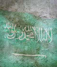 Stylized Image Of Flag Of Saudi Arabia Against The Old Wall Background
