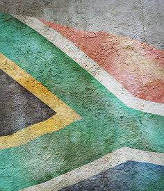 Stylized Image Of Flag Of South Africa Against The Old Wall Background
