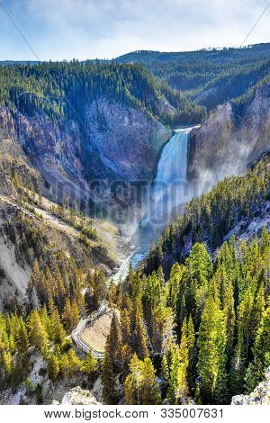 Lower Falls At Yellowstone National Park Showing Rushing Waters Of The Waterfall From The Yellowston