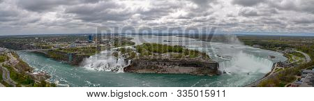 Niagara Falls, Usa - May 16 2016 : Panoramic View Over Niagara Falls As It Gushes Fast Over The Clif