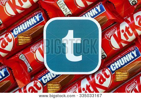 Tumblr Paper Logo On Many Kit Kat Chocolate Covered Wafer Bars In Red Wrapping. Advertising Chocolat