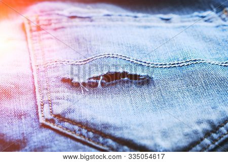 Frayed Back Pocket Of Jeans.hippie Style.old And Modern Clothes.