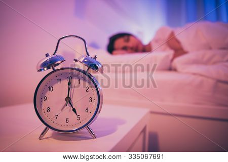 Close-up View Of Bell Signal Clock Nice Attractive Peaceful Dreamy Girl Lying In Bed Covered By Soft