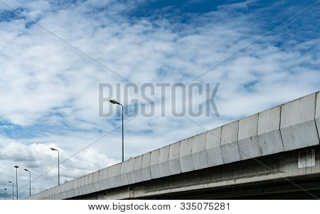 Elevated Concrete Highway And Street Lamp Pole. Overpass Concrete Road. Road Flyover. Modern Motorwa