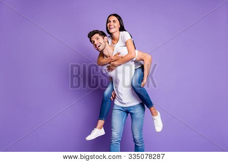 Photo Of Cheerful Positive Cute Pretty Excited Fashionable Couple Piggyback Girl Hugging Guy Carryin