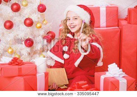 Letter For Santa. Wish List. I Was Good Girl All Year. Girl Little Kid Hold Pen And Paper Near Chris