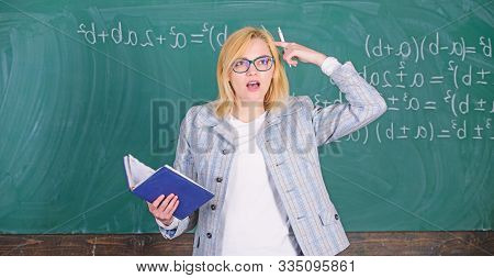 Teacher Woman Explain Near Chalkboard. School Teacher Explain Things Well And Make Subject Interesti
