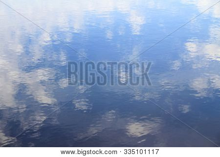Clouds Reflection In Pure Lake Water. Heaven And Clouds In Water