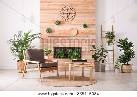 Stylish Living Room Interior With Armchair, Green Plants And Miniature Zen Garden. Home Design Ideas