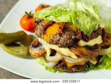 Keto Burger, Lettuce Wrapped Burger, Stacked With 2 Patties, Mushrooms, Onion, Sundried Tomato, Chee