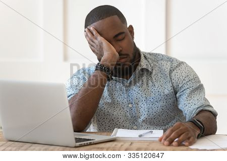 Tired african American fall asleep studying at laptop poster