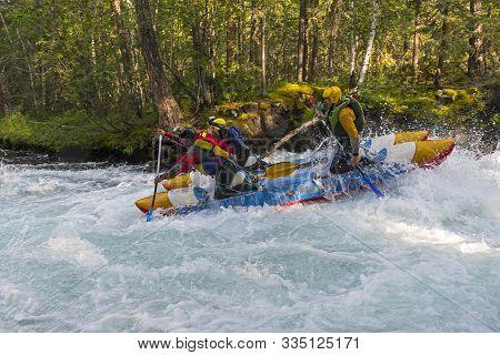 Buryatia, Russia - July 31, 2019: Sports Catamaran On The Rapids. The