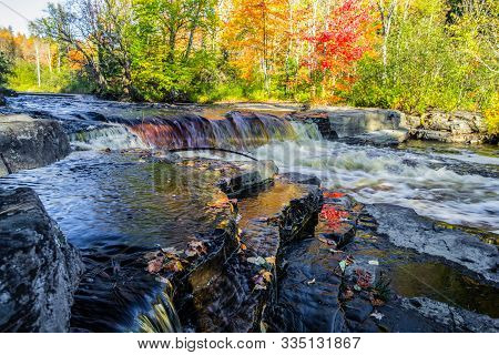 Michigan Autumn River Landscape. Beautiful Fall Foliage Reflected In The Sturgeon River At Canyon Fa