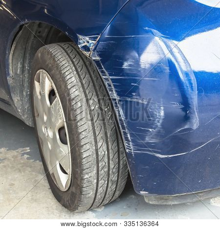 Scratched And Dented Car. Damaged Part Of The Car In The Event Of A Tamponage Or Car Accident.