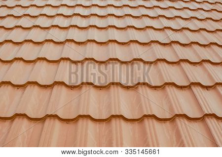 Modern Roof Made Of Metal. Corrugated Metal Roof And Metal Roofing. House With An Orange Metal Roof.