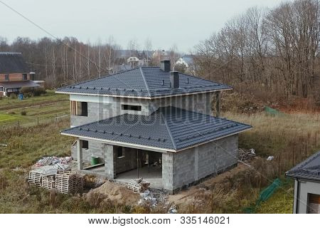 Modern Roof Made Of Metal. Corrugated Metal Roof And Metal Roofing. New Houses Under Construction In