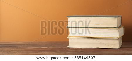 Stack Of Books On The Wooden Table. Education Background. Back To School. Copy Space For Text.