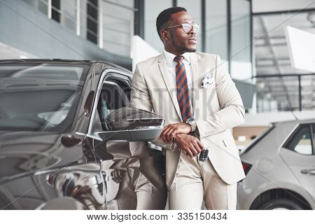 The Young Attractive Black Businessman Buys A New Car, Dreams Come True.