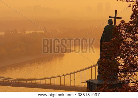Scenic Morning View Of Monument Of Saint Vladimir (volodymyr The Great), Dnipro River And Pedestrian