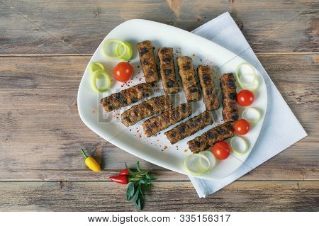 Balkan Cuisine. Cevapi - Grilled Dish Of Minced Meat.  Rustic Background, Flat Lay, Free Space For T