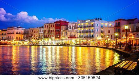 Illuminated Venetian Habour Of Chania At Night, Crete Greece, Web Banner Format