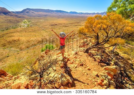 Carefree Woman Looking At Mount Sonder, One Of Highest Mountains In Northern Territory, Australia Ou