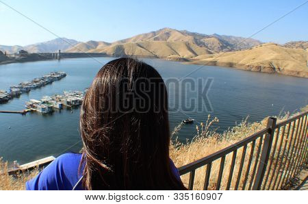 Little Girl Looking At House Boats In Water