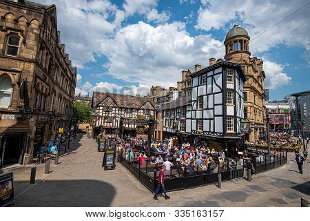 Manchester, United Kingdom, July 16 2019: People Sitting And Enjoy Their Beer Outside The Old Wellin