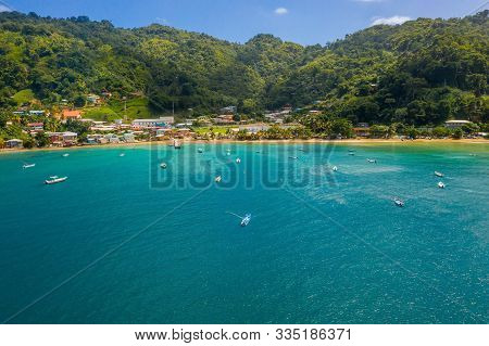 Aeria Lview Of The Tobago Island From Above. Blue Caribbean Sea With Huge Waves By The Beach.