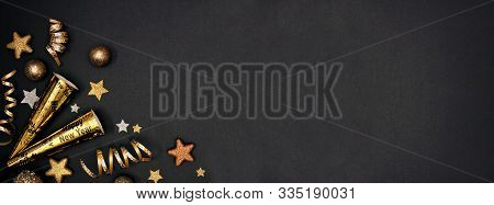 New Years Eve Corner Border Banner Of Glittery Gold Stars, Streamers, Decorations And Noisemakers. T