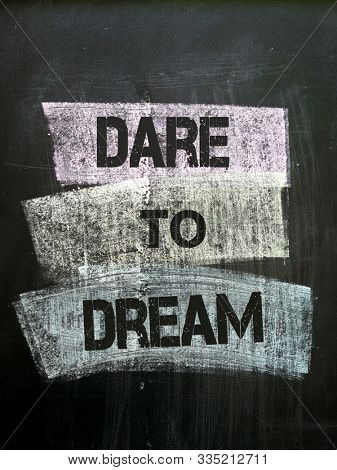 Dare to dream, written with chalk and stencil