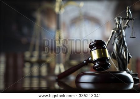Judge Concept. Gavel Of  The Judge, Scale Of Justice And Themis Statue In The Old Court Library.
